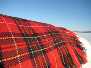 A red shawl on the snow.