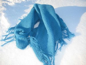 A blue shawl on the snow.